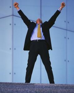 Businessman Raising Arms
