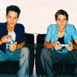 Two Teenage Boys Playing Video Games