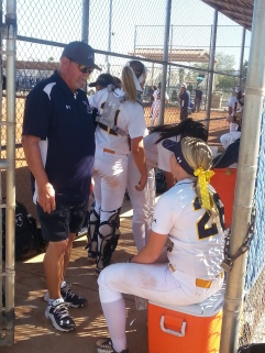 Assistant Softball Coach Mark Stoner with players